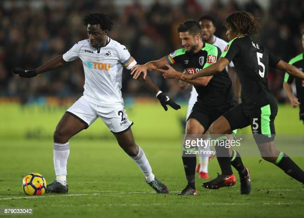 Wilfried Bony of Swansea City breaks away from AFC Bournemouth players during the Premier League match between Swansea City and AFC Bournemouth at...