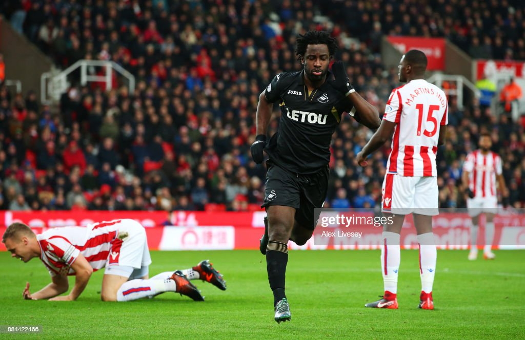 Wilfried Bony of Swansea City celebrates after scoring his sides first goal during the Premier League match between Stoke City and Swansea City at Bet365 Stadium on December 2, 2017 in Stoke on Trent, England.