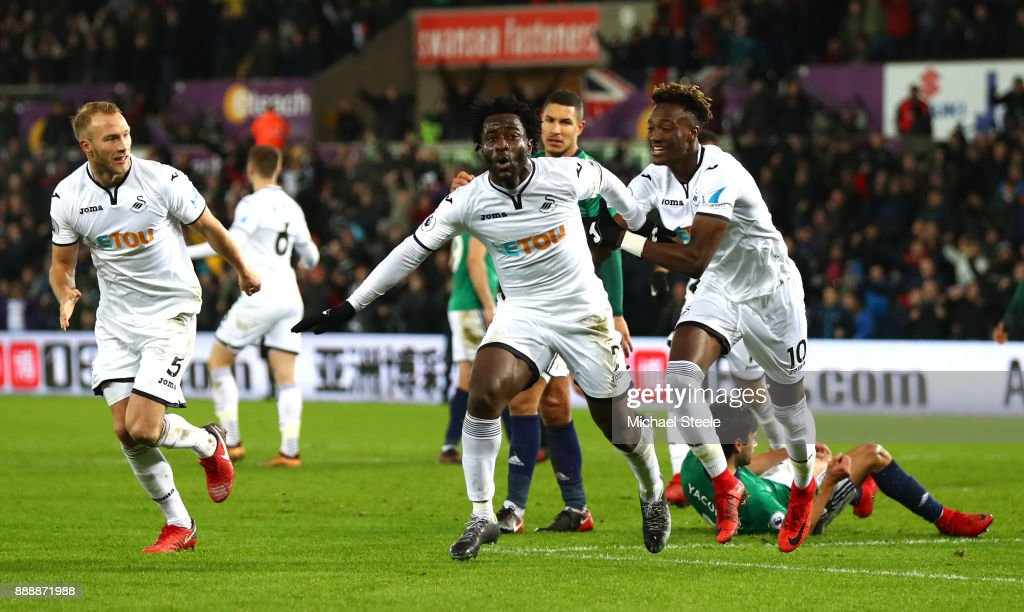 Wilfried Bony of Swansea City celebrates after scoring his sides first goal with Tammy Abraham of Swansea City during the Premier League match between Swansea City and West Bromwich Albion at Liberty Stadium on December 9, 2017 in Swansea, Wales.