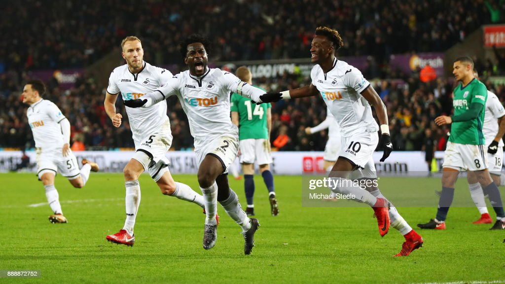 Wilfried Bony of Swansea City celebrates after scoring his sides first goal during the Premier League match between Swansea City and West Bromwich Albion at Liberty Stadium on December 9, 2017 in Swansea, Wales.