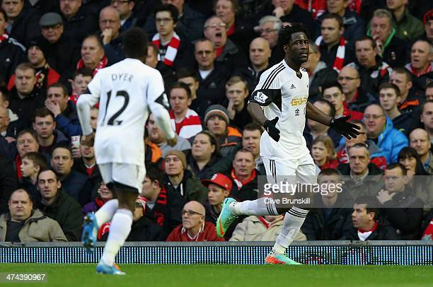 Wilfried Bony of Swansea City celebrates scoring his team's second goal during the Barclays Premier League match between Liverpool and Swansea City...