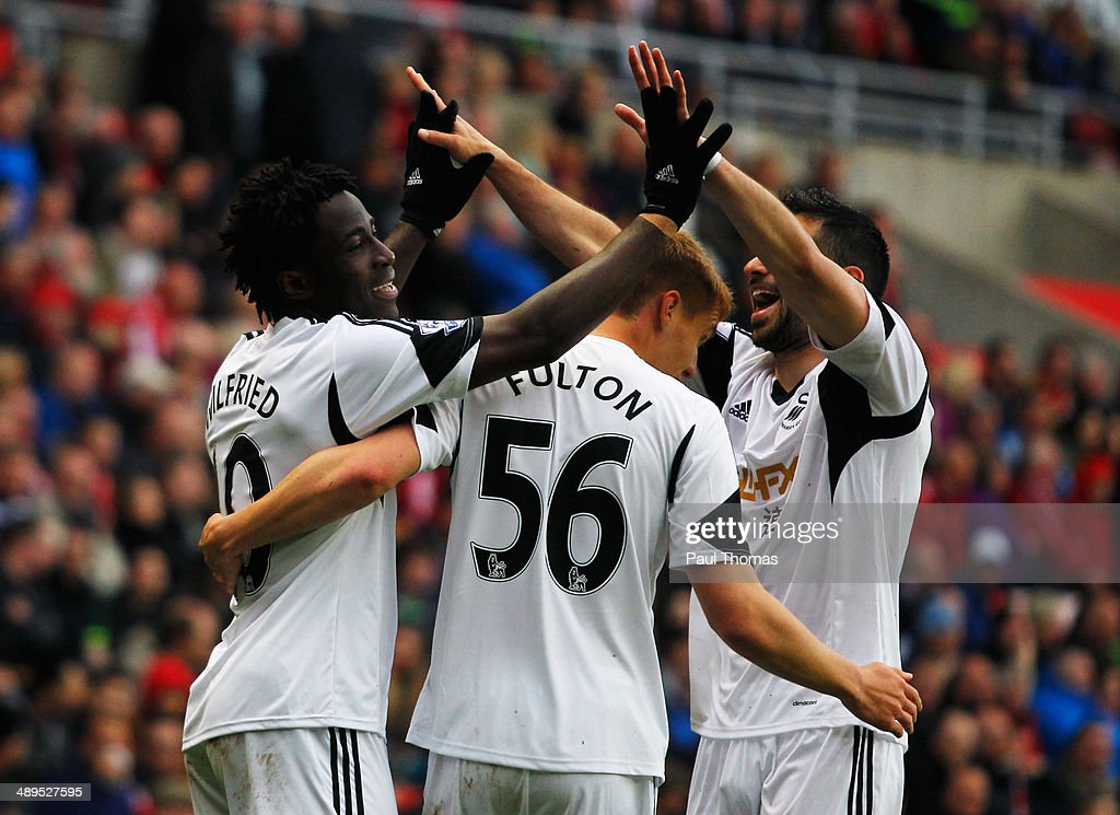 Wilfried Bony of Swansea City (L) celebrates with Jay Fulton (C) and Jordi Amat (R) as he scores their third goal during the Barclays Premier League match between Sunderland and Swansea City at Stadium of Light on May 11, 2014 in Sunderland, England.