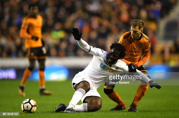 Wilfried Bony of Swansea City goes to ground under pressure from Barry Douglas of Wolverhampton Wanderers during the The Emirates FA Cup Third Round...