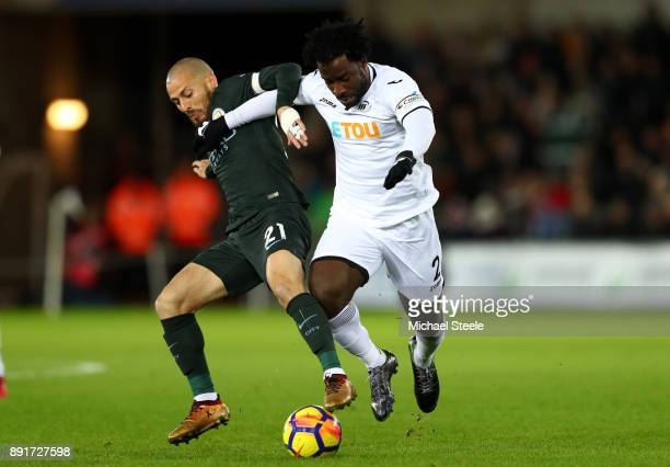 Wilfried Bony of Swansea City is challenged by David Silva of Manchester City during the Premier League match between Swansea City and Manchester...