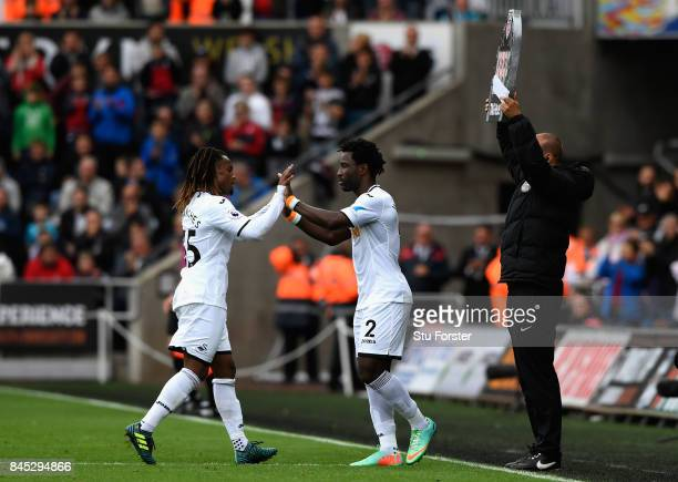 Wilfried Bony of Swansea City replaces Renato Sanches of Swansea City during the Premier League match between Swansea City and Newcastle United at...