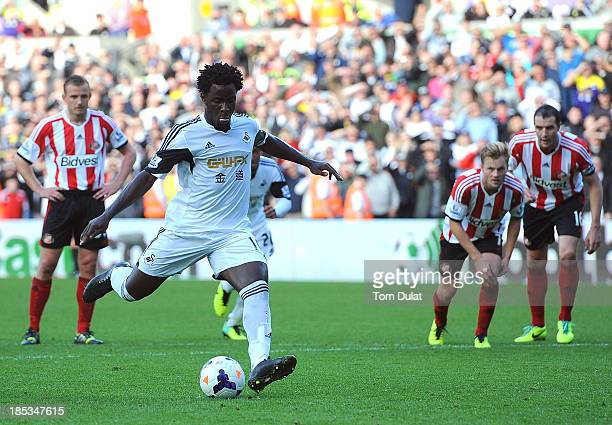 Wilfried Bony of Swansea City scores a penalty during the Barclays Premier League match between Swansea City and Sunderland at Liberty Stadium on...