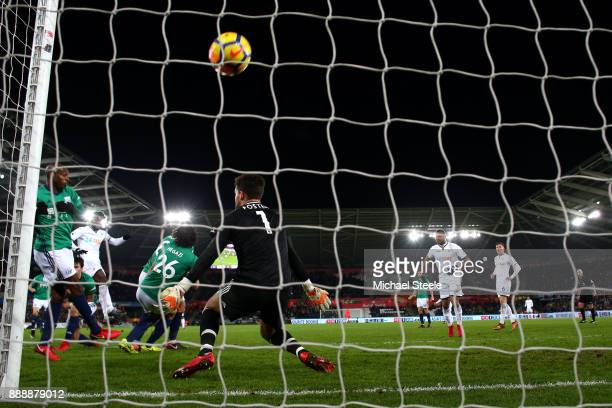 Wilfried Bony of Swansea City scores his sides first goal past Ben Foster of West Bromwich Albion during the Premier League match between Swansea...