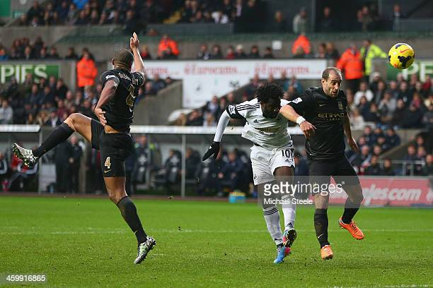 Wilfried Bony of Swansea City scores his sides opening goal as Pablo Zabaleta of Manchester City fails to challenge during the Barclays Premier...