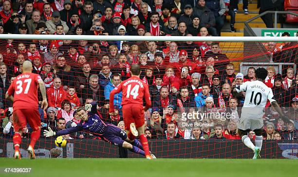 Wilfried Bony of Swansea City scores his team's third goal during the Barclays Premier League match between Liverpool and Swansea City at Anfield on...