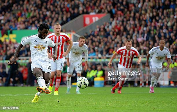 Wilfried Bony of Swansea City scores the first goal from the penalty spot during the Barclays Premier League match between Stoke City and Swansea...