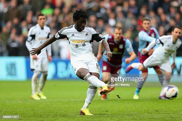 Wilfried Bony of Swansea City scores their fourth goal from the penalty spot during the Barclays Premier League match between Swansea City and Aston...