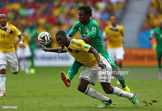 Wilfried Bony of the Ivory Coast and Cristian Zapata of Colombia compete for the ball during the 2014 FIFA World Cup Brazil Group C match between...