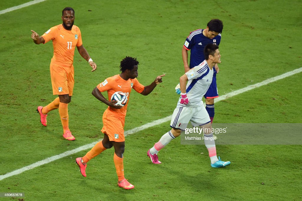 Wilfried Bony of the Ivory Coast (2nd L) celebrates scoring his team's first goal with Didier Drogba (L) as goalkeeper Eiji Kawashima of Japan reacts during the 2014 FIFA World Cup Brazil Group C match between the Ivory Coast and Japan at Arena Pernambuco on June 14, 2014 in Recife, Brazil.