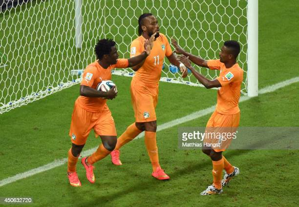 Wilfried Bony of the Ivory Coast celebrates scoring his team's first goal with Didier Drogba and Salomon Kalou during the 2014 FIFA World Cup Brazil...