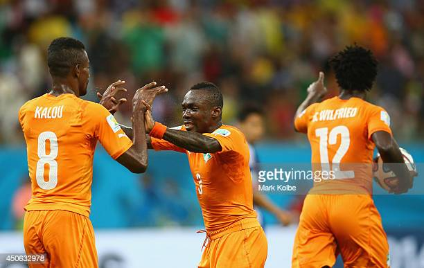 Wilfried Bony of the Ivory Coast celebrates scoring his team's first goal with teammates Salomon Kalou and Arthur Boka during the 2014 FIFA World Cup...