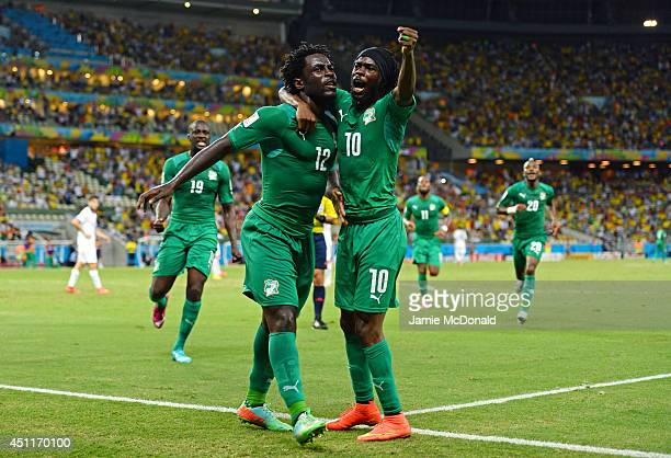 Wilfried Bony of the Ivory Coast celebrates scoring his team's first goal with Gervinho during the 2014 FIFA World Cup Brazil Group C match between...