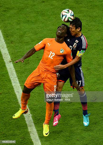 Wilfried Bony of the Ivory Coast goes up for the ball with Makoto Hasebe of Japan during the 2014 FIFA World Cup Brazil Group C match between Cote...