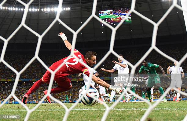 Wilfried Bony of the Ivory Coast scores his team's first goal past Panagiotis Glykos of Greece during the 2014 FIFA World Cup Brazil Group C match...