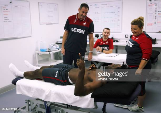 Wilfried Bony speaks with manager Paul Clement during his medical with club physiotherapist Kate Rees at the Swansea City FC Fairwood Training Ground...