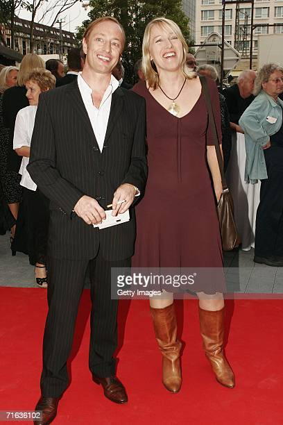 Wilfried Hochholdinger and Catharina Deus attend the premiere of the play Die Dreigroschenoper at the Admiralspalast August 11 2006 in Berlin Germany...