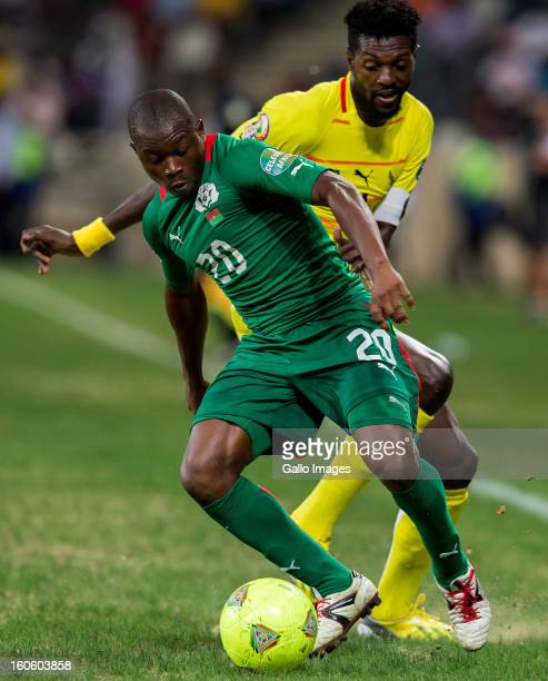 Wilfried Leon Bakary Sanou of Burkina Faso and Emmanuel Adebayor of Togo during the 2013 African Cup of Nations 4th Quarter Final match between...