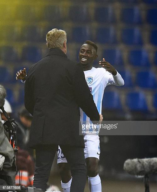 Wilfried Ndidi midfielder of KRC Genk celebrates with teammates after scoring pictured during the Uefa Europa League group F between KRC Genk and...