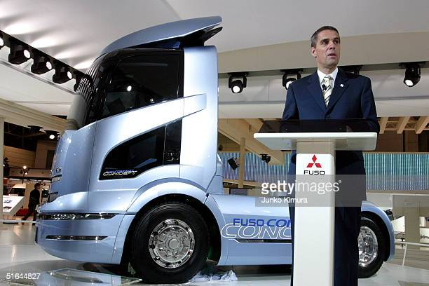 Wilfried Porth the President and CEO of Mitsubishi FUso Truck Bus Corporation speaks in front of Fuso's concept car Fuso Concept during the 38th...