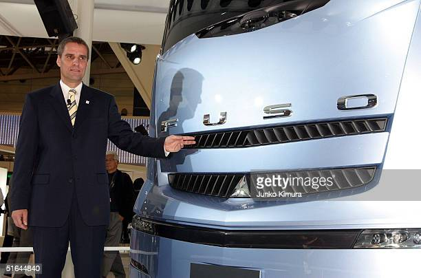 Wilfried Porth the President and CEO of Mitsubishi FUso Truck Bus Corporation stands in front of Fuso's concept car Fuso Concept during the 38th...
