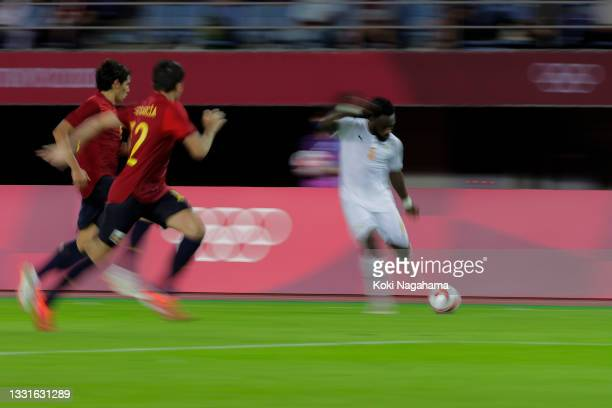 Wilfried Singo of Team Ivory Coast runs with the ball during the Men's Quarter Final match between Spain and Cote d'Ivoire on day eight of the Tokyo...