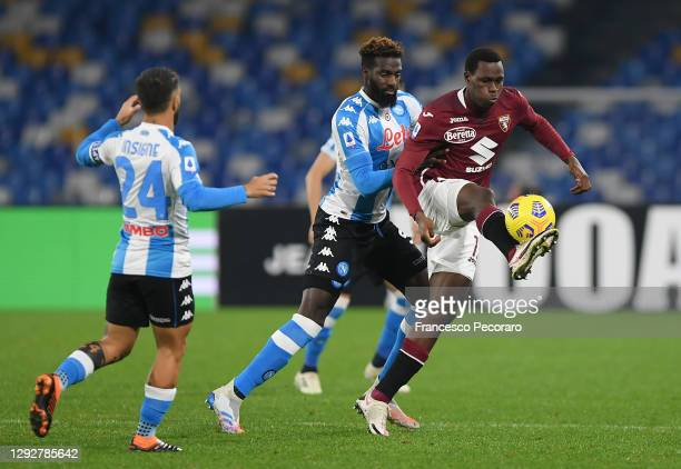 Wilfried Singo of Torino battles for possession with Tiemoue Bakayoko of SSC Napoli during the Serie A match between SSC Napoli and Torino FC at...