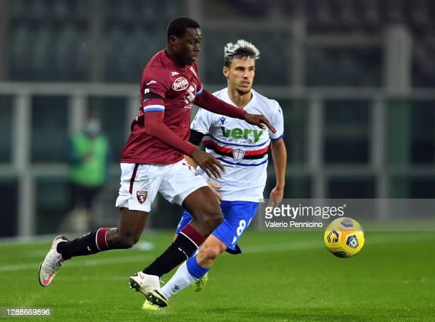 Wilfried Singo of Torino F.C. Battles for possession with Jakub Jankto of U.C. Sampdoria and Valerio Verre of U.C. Sampdoria during the Serie A match...