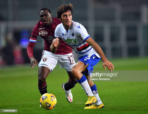 Wilfried Singo of Torino F.C. Battles for possession with Tommaso Augello of U.C. Sampdoria during the Serie A match between Torino FC and UC...