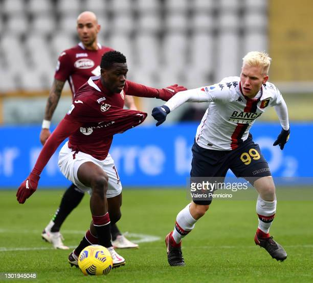 Wilfried Singo of Torino FC battles is challenged by Lennart Czyborra of Genoa during the Serie A match between Torino FC and Genoa CFC at Stadio...