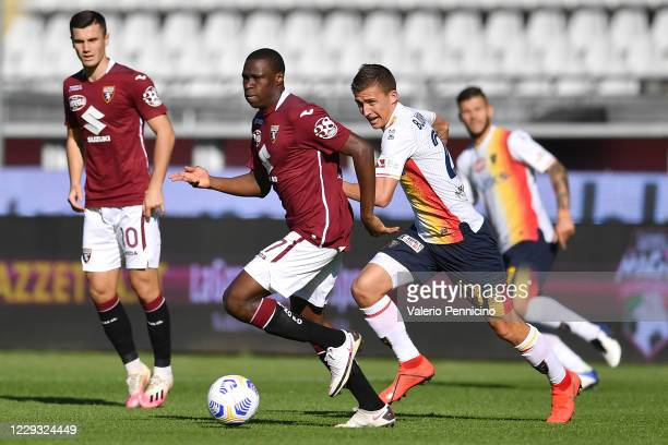 Wilfried Singo of Torino FC in sction against John Gunnar Bjorkengren of US Lecce during the Coppa Italia match between Torino FC and US Lecce at...