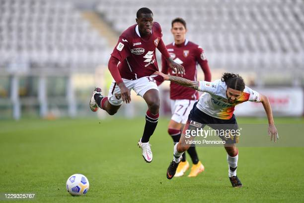 Wilfried Singo of Torino FC is challenged by Leonard Zuta of US Lecce during the Coppa Italia match between Torino FC and US Lecce at Stadio Olimpico...