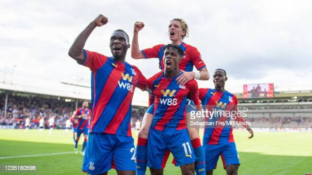 Wilfried Zaha celebrates with Christian Benteke, Conor Gallagher, Tyrick Mitchell after scoring their first goal during the Premier League match...