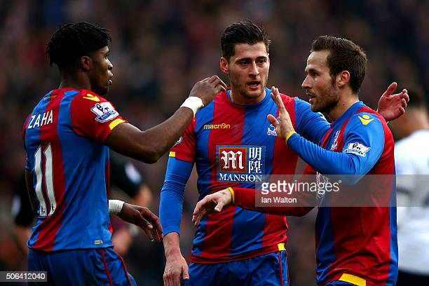 Wilfried Zaha Joel Ward and Yohan Cabaye of Crystal Palace celebrate their team's first goal scored by Jan Vertonghen of Tottenham Hotspur during the...