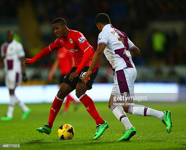 Wilfried Zaha of Cardiff City and Leandro Bacuna of Aston Villa battle for the ball during the Barclays Premier League match between Cardiff City and...