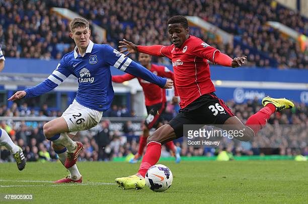 Wilfried Zaha of Cardiff City competes with John Stones of Everton during the Barclays Premier League match between Everton and Cardiff City at...