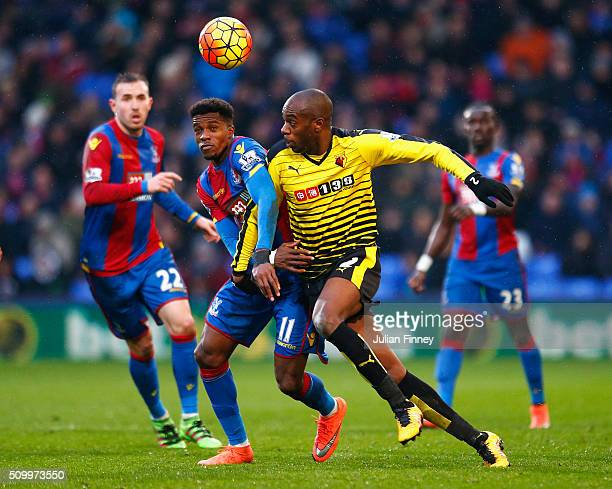Wilfried Zaha of Crystal Palace and AllanRomeo Nyom of Watford compete for the ball during the Barclays Premier League match between Crystal Palace...
