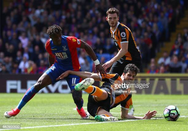 Wilfried Zaha of Crystal Palace and Andrea Ranocchia of Hull City battle for possession during the Premier League match between Crystal Palace and...