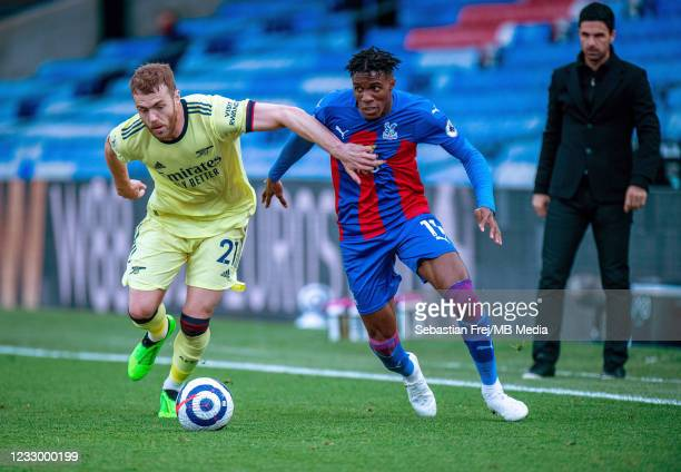 Wilfried Zaha of Crystal Palace and Calum Chambers of Arsenal in action during the Premier League match between Crystal Palace and Arsenal at...