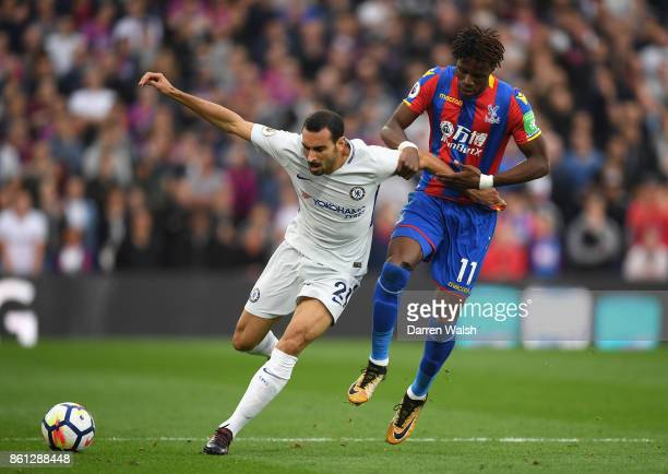 Wilfried Zaha of Crystal Palace and Davide Zappacosta of Chelsea battle for possssion during the Premier League match between Crystal Palace and...