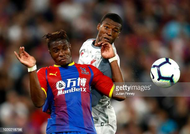 Wilfried Zaha of Crystal Palace and Georginio Wijnaldum of Liverpool battle for the header during the Premier League match between Crystal Palace and...