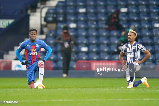 Wilfried Zaha of Crystal Palace and Grady Diangana of West Bromwich Albion take a knee in support of the Black Lives Matter movement prior to the...