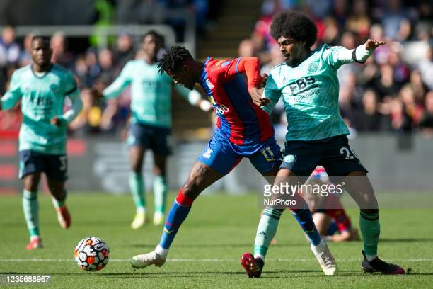Wilfried Zaha of Crystal Palace and Hamza Choudhury of Leicester battle for the ball during the Premier League match between Crystal Palace and...