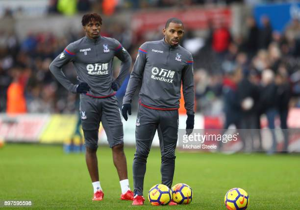 Wilfried Zaha of Crystal Palace and Jason Puncheon of Crystal Palace warm up prior to the Premier League match between Swansea City and Crystal...
