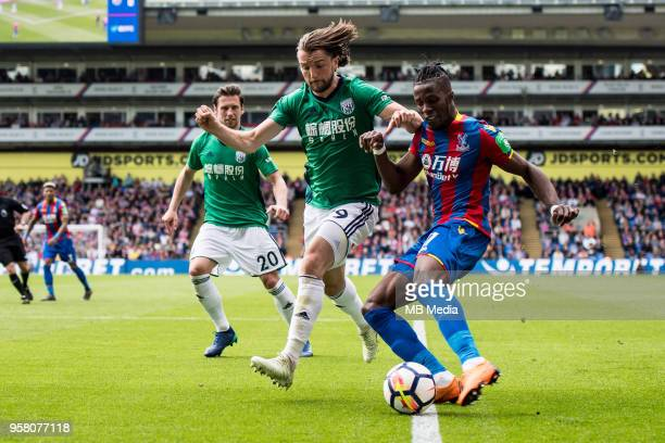 Wilfried Zaha of Crystal Palace and Jay Rodriguez of West Bromwich Albion in action during the Premier League match between Crystal Palace and West...