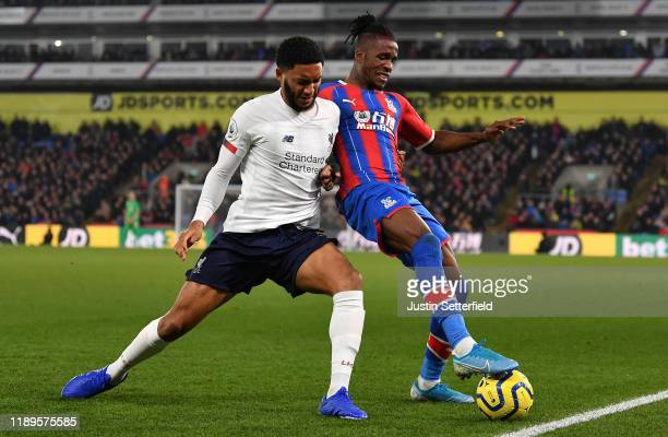 Wilfried Zaha of Crystal Palace and Joe Gomez of Liverpool in action during the Premier League match between Crystal Palace and Liverpool FC at...