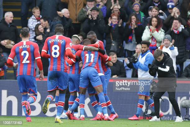 Wilfried Zaha of Crystal Palace and Jordan Ayew of Crystal Palace celebrating his teams first goal during the Premier League match between Crystal...